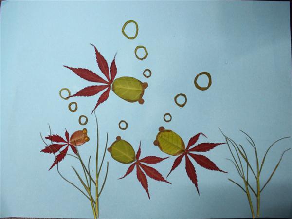 """开展了以""""春天""""为主题的树叶粘贴画创作实践活动"""