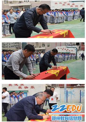 学校领导参加防溺水签名活动