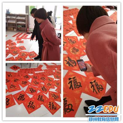 """广电社区工作人员用手机在扫满地的""""福"""""""