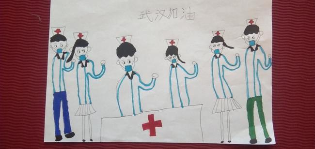 2.孩子们用画笔向白衣天使和武汉加油